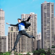Businessman falling in city center